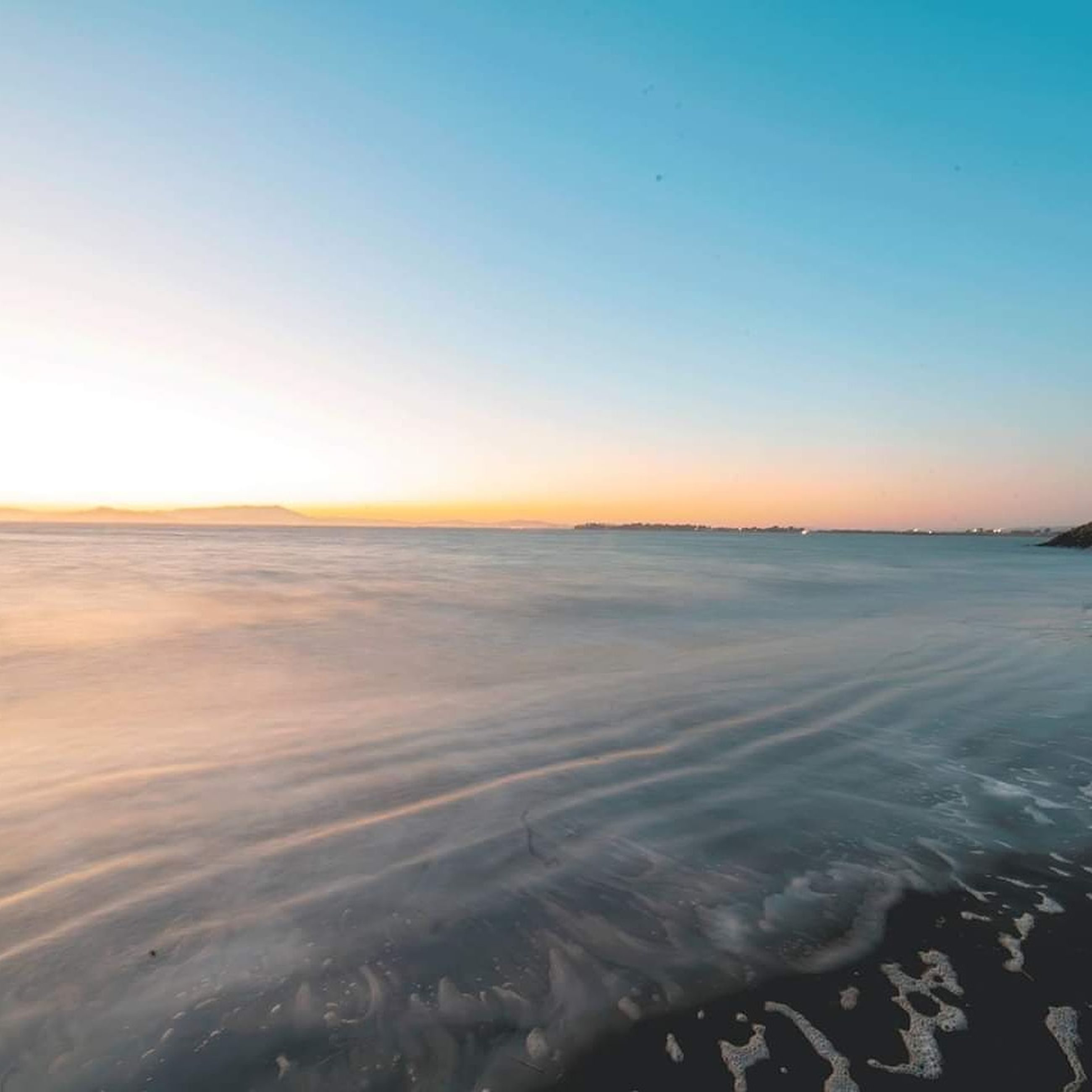 sky, sea, beauty in nature, scenics - nature, water, beach, land, tranquility, tranquil scene, clear sky, copy space, nature, horizon, no people, sunset, idyllic, horizon over water, outdoors, non-urban scene