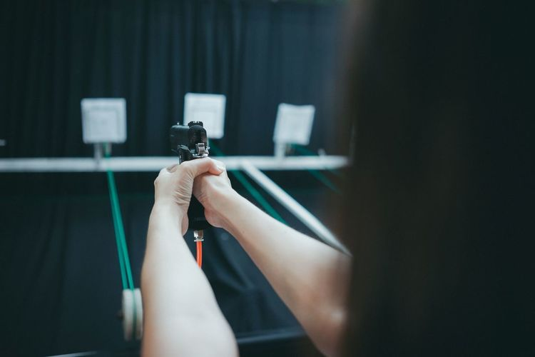 Close-up of woman target shooting