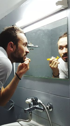 Backstage of hotel life: Before morning shift Drops Mirror Reflection Mirror Reflection Shaving Yellow Tiled Wall Bathroom Minimalism Young Men Backstage Of Hotel Life Echo_of_sirens Kajo Adventure Traveler Indoors  Water Drops Portrait Morning Shift Receptionist Water Close-up Shower The Portraitist - 2018 EyeEm Awards