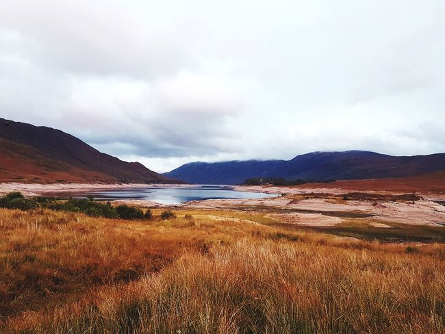 Landscape Dramatic Sky Nature Scenics Beauty In Nature Mountain Outdoors Cloud - Sky Tranquility Water Travel Destinations No People Lake Vacations Flamingo Glencoe Scotland Autumn🍁🍁🍁 EyeEmNewHere Highlands Of Scotland Grass The Week On EyeEm Scotland Nature Colors Mountain Range Nature