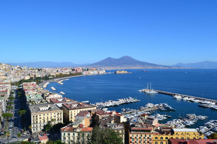 Naples Vesuvio Architecture Blue Building Exterior Built Structure City Cityscape Clear Sky Day Harbor High Angle View Mountain Nature No People Outdoors Residential Building Sea Sky Sunny Town Travel Destination Travel Destinations Vesuviocoast Water