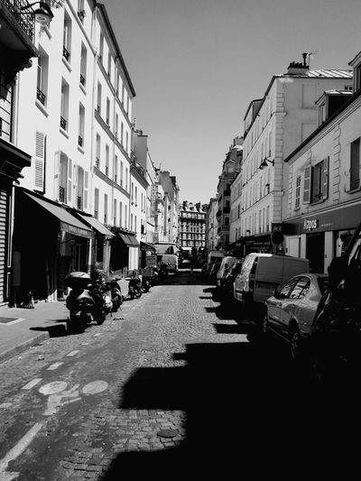 Paris Street Streetphotography Blackandwhite Day Daylight Daytime Light Light And Shadow Cars City Streets  City Cityscape Monmartre Quartier Neighborhood City Car Building Exterior Outdoors Architecture Sky No People No Clouds Clear Sky Welcome To Black