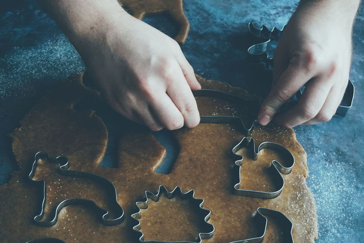 Close up of man baking gingerbread cookies for christmas