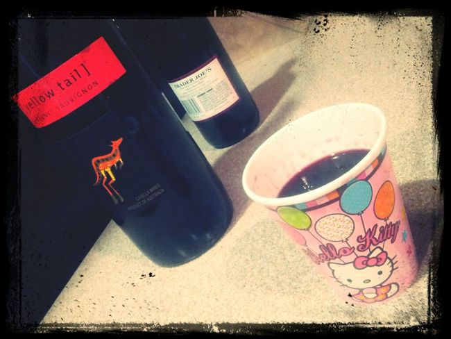 classy wine in a paper hello kitty cup...its how we do it. still unpacking...<3