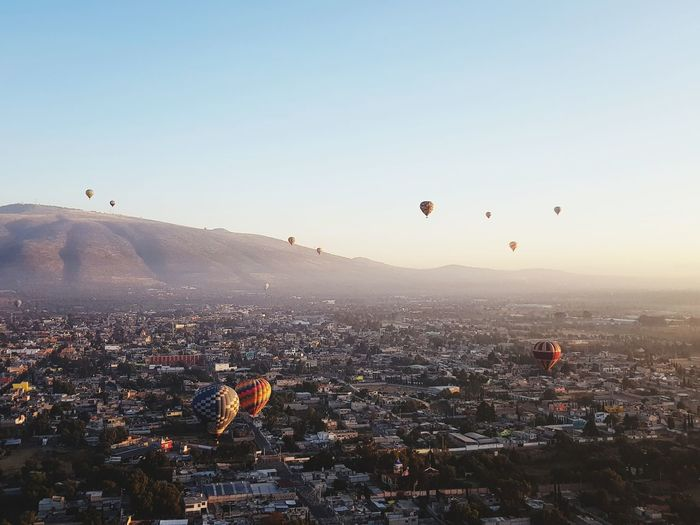Hot Air Balloons Flying In City