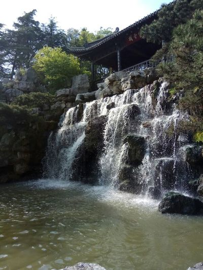 Waterfall Motion Power In Nature Beauty In Nature Water Day Sky River Tree Outdoors No People Nature Scenics