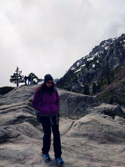 Woman walking on mountain against sky at sierra nevada