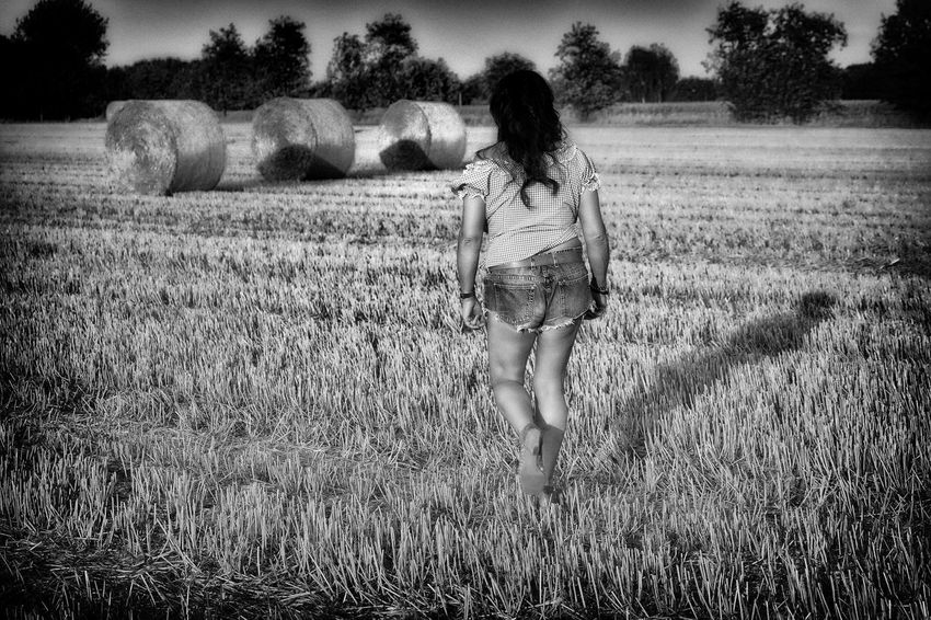 Black & White Adult Black And White Bw_collection Bw_lover Bwphotography Casual Clothing Day Field Grass Land Landscape Leisure Activity Lifestyles Nature One Person Outdoors Real People Stubble Field Stubblefield Walking Women Young Adult Young Women