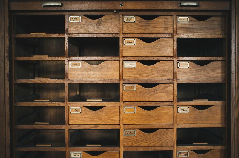 Shelf Indoors  Storage Compartment Shelves In A Row Stack Full Frame Wood - Material Cabinet Filing Cabinet Wine Rack Cellar Backgrounds No People Large Group Of Objects Library Architecture Day Archives Bookshelf