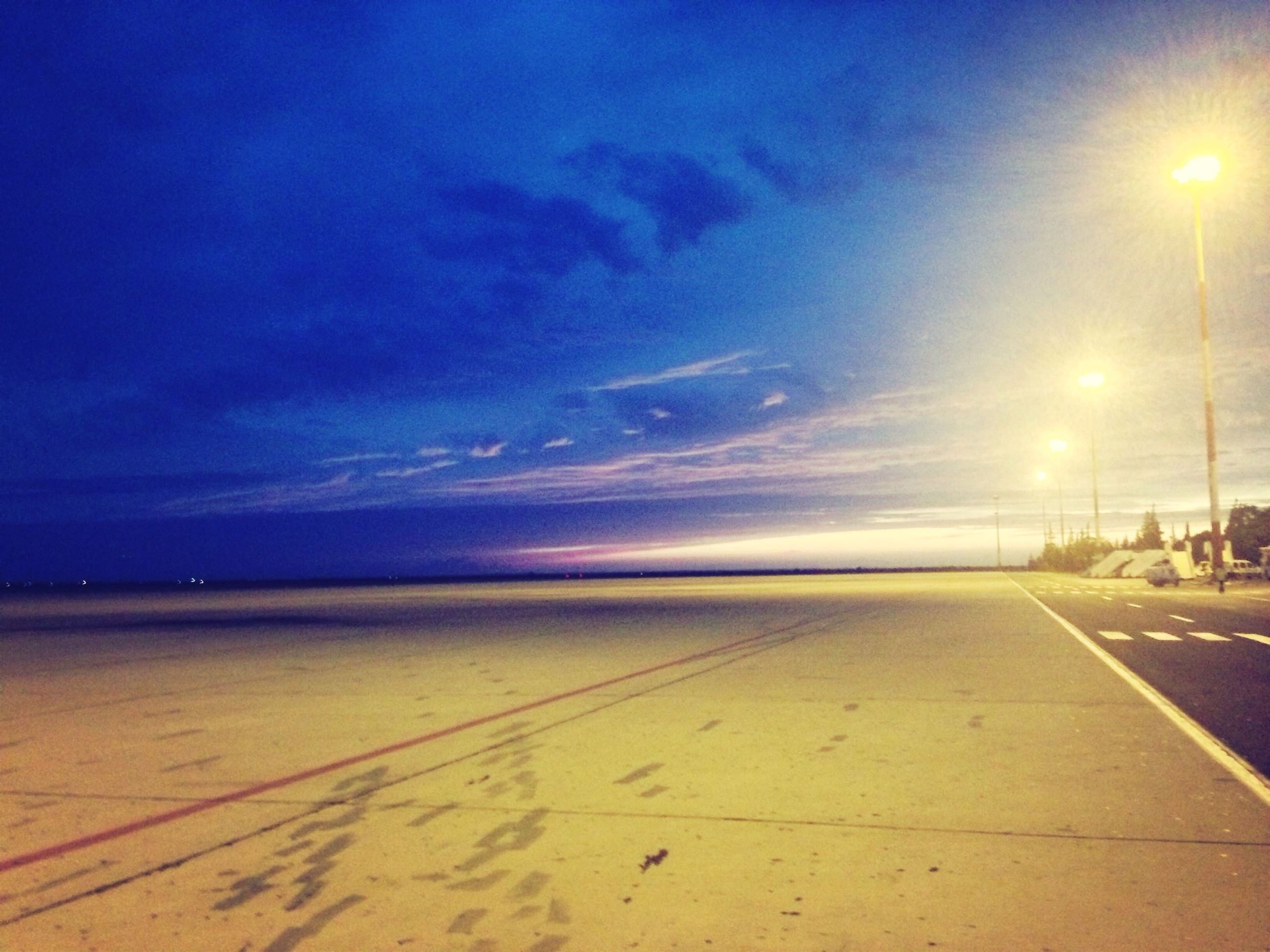 sea, beach, horizon over water, sky, water, tranquil scene, tranquility, scenics, sand, shore, beauty in nature, the way forward, nature, cloud - sky, blue, idyllic, street light, sunset, incidental people, cloud