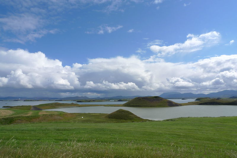 Blue Color Myvatn Beauty In Nature Cloud - Sky Clouds Crater Day Field Grass Green Color Idyllic Island Lake Landscape Mountain Nature No People Outdoors Rural Scene Scenics Sky Tranquil Scene Tranquility Vulcanic Water