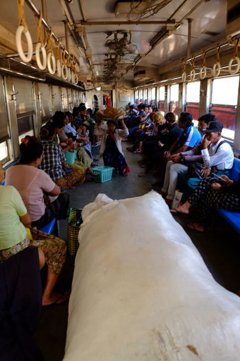 Yangon Circular Train Carriage Full of People Ceiling Fans City City Life City Lifestyle Composition Crowd Full Frame Full Length Full Of People Indoor Photography Large Group Of People Men And Women Mode Of Transport Myanmar People Public Transportation Railway Carriage Side By Side Tourist Attraction  Tourist Destination Traditional Clothing Travel Destination Yangon Yangon Circular Railway Yangon Circular Train