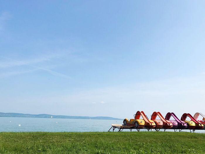 Sky Land Sea Water Nature Day Beauty In Nature Beach Outdoors Scenics - Nature Horizon Horizon Over Water Grass