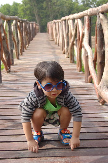 The joy of childhood Boys Casual Clothing Child Childhood Day Fashion Footpath Front View Full Length Innocence Leisure Activity Lifestyles Looking At Camera Males  One Person Outdoors Portrait Real People Wood - Material
