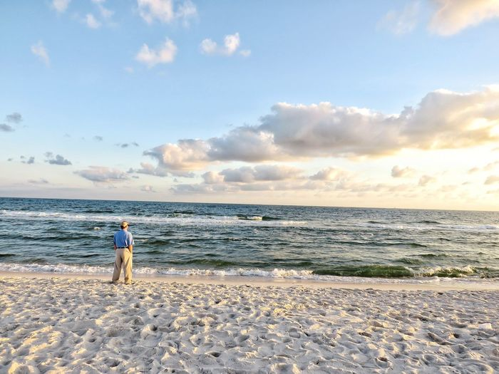 The vast open power of the ocean Water Sea Full Length Beach Standing Sand Summer Sky Horizon Over Water Cloud - Sky Low Tide Shore Rushing Sandy Beach Ocean Coastline Calm Wave Surf Tide
