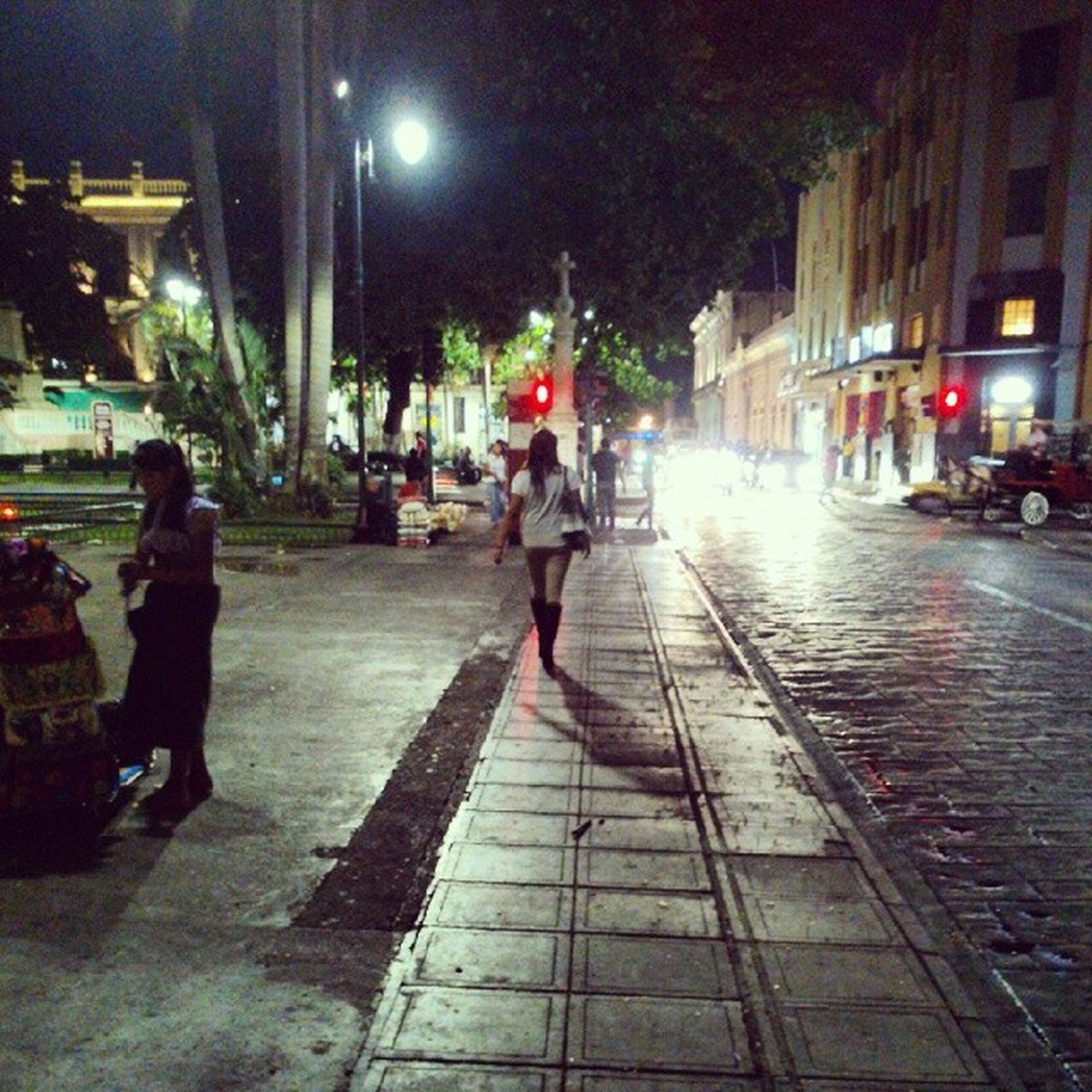 street, city, building exterior, illuminated, night, walking, city life, architecture, city street, the way forward, full length, built structure, lifestyles, transportation, street light, men, rear view, car, person