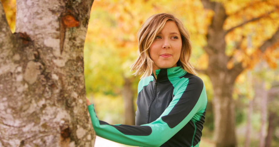 Adult Autumn Beautiful Woman Change Day Fashion Focus On Foreground Forest Leaf Leisure Activity Lifestyles Looking At Camera Nature One Person One Woman Only Only Women Outdoors Portrait Real People Standing Tree Tree Trunk Women Young Adult Young Women