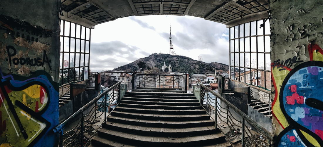 Once a cable car used to connect this place to the mountain. It all ended on June 1st, 1990. Unexpectedly... Abandoned Places Abandoned Buildings Abandoned Tbilisi Georgia Georgian Architecture Mountain Peak City Arch Staircase Steps And Staircases Arcade Historic Archway Steps Stairway Arch Bridge Stairs