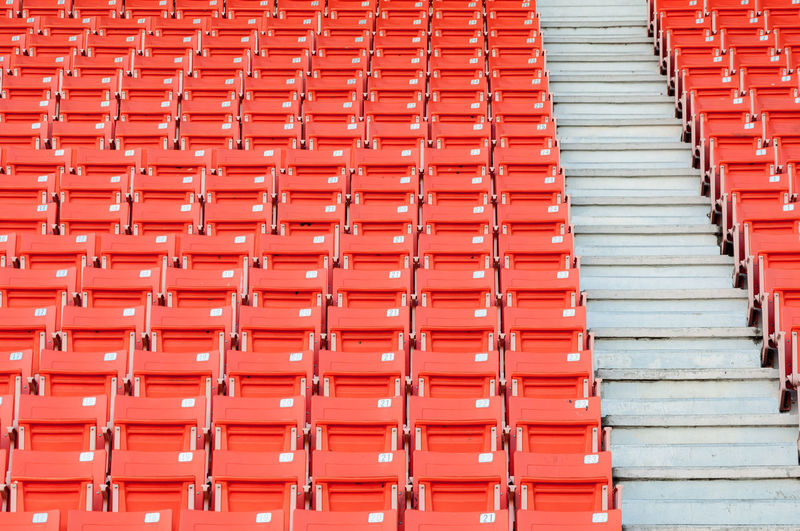 Low angle view of orange bleachers at stadium