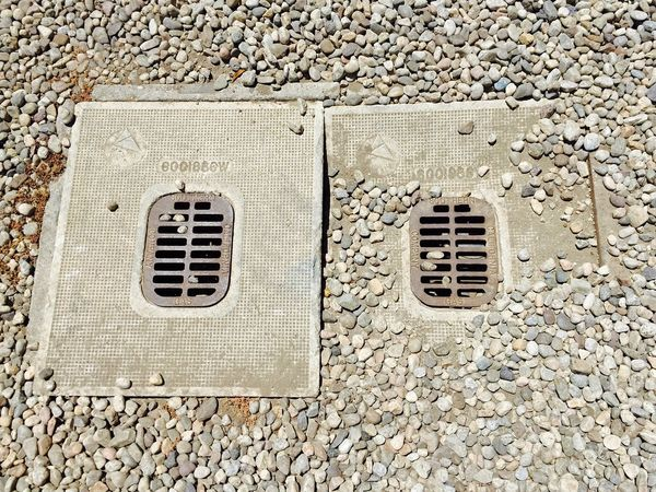 The OO Mission Seeing Double Two On The Ground Rocks Grates Covers Looking Down Color Palette Adapted To The City