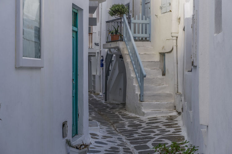 Mykonos, Greece whitewashed alleys. Traditional dotted narrow alleys with painted doors and white stairs at Mykonos Town (Chora). Aegean AlleyShots Architecture GREECE ♥♥ Greek Greek Islands Mediterranean  Mykonos Whitewashed Alleys Mykonos Town Travel White Stairs Alley Chora Mykonos Cyclades Greece Greece Islands Greek Island Houses Island Mykonos Narrow Alleys Summer Traditional Vacation White Whitewashed