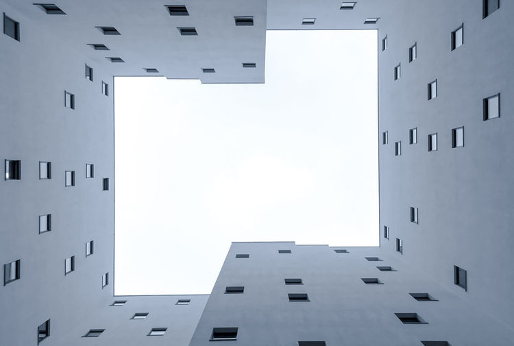 Architecture City Modern Sky Animal Building Window Day Outdoors Monochrome Clear Sky Apartment No People Copy Space White Color Low Angle View Building Exterior Residential District Built Structure Directly Below Vertebrate Krull&krull Backyards