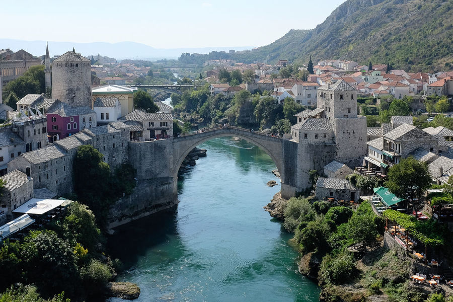 Elevated view of Mostar Bridge Mostar Mostar Bridge Architecture Beauty In Nature Bosnia Building Exterior Built Structure Clear Sky Day High Angle View History Mountain Nature No People Outdoors River River Tara Sky Stari Most Travel Destinations Tree Water