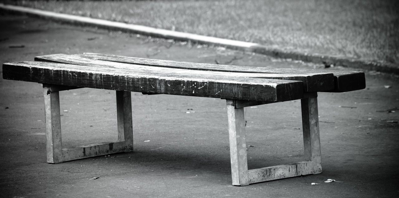 Wooden Bench On Footpath