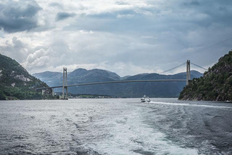 Bridge over bay against sky