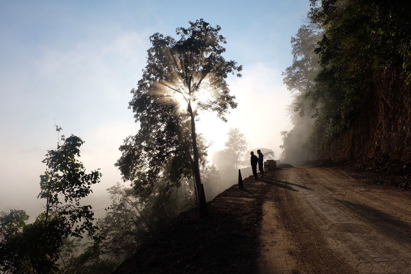 Silhouette Full Length Two People People Spraying Adult Togetherness Men Tree Child Sky Day Nature Only Men Outdoors Foggy Morning Morning Light Spirituality Morning View Winter Wintertime Northofthailand