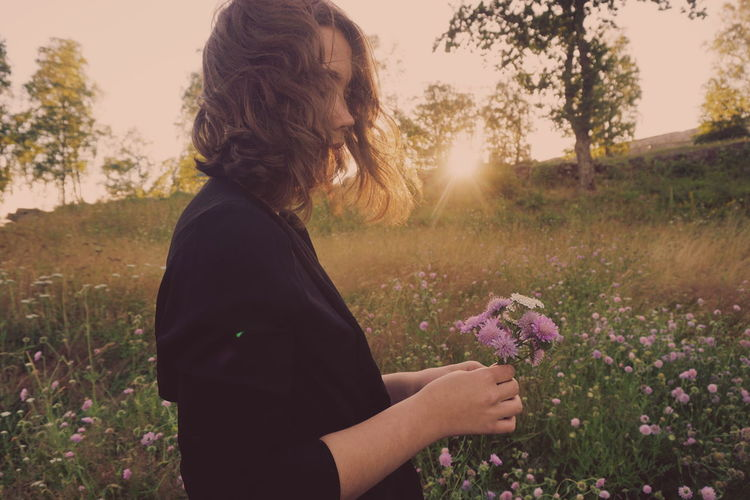 Picking flowers Beauty In Nature Day Field Flower Flower Head Fragility Freshness Growth Holding Lifestyles Nature One Person Outdoors People Picking Flowers  Plant Purple Real People Sky Summer Sunset Wild Flowers Women Young Adult Young Women Perspectives On Nature