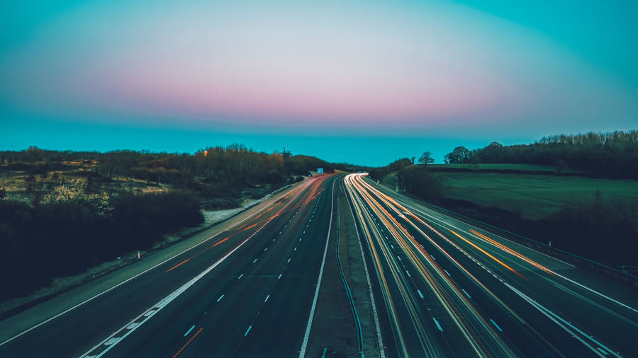 High angle view of light trails on highway
