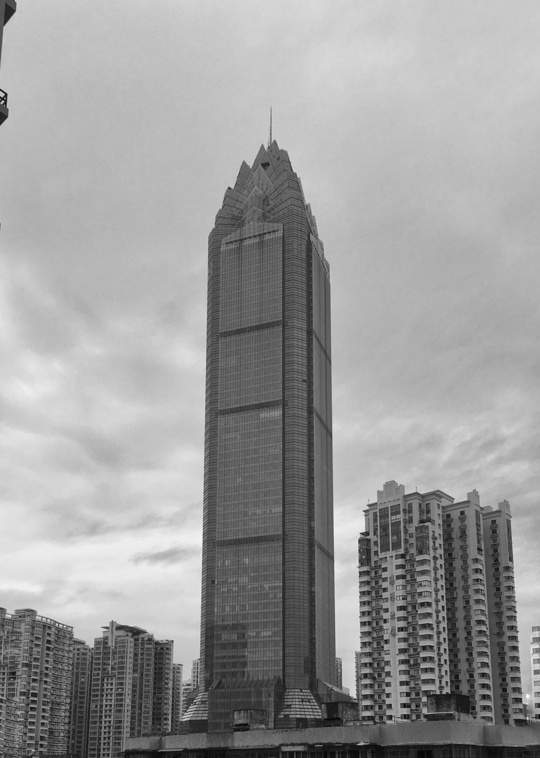 architecture, skyscraper, building exterior, modern, city, built structure, tall - high, tower, sky, cityscape, no people, tall, urban skyline, outdoors, day