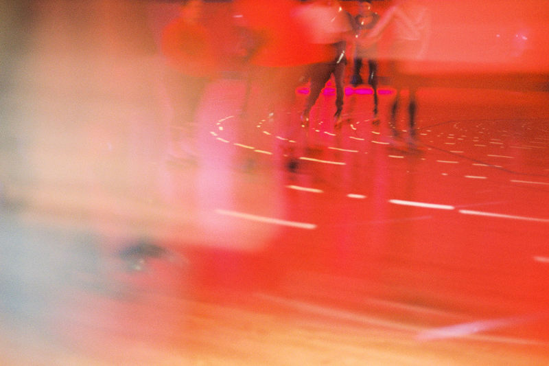 Low section of people on red glass