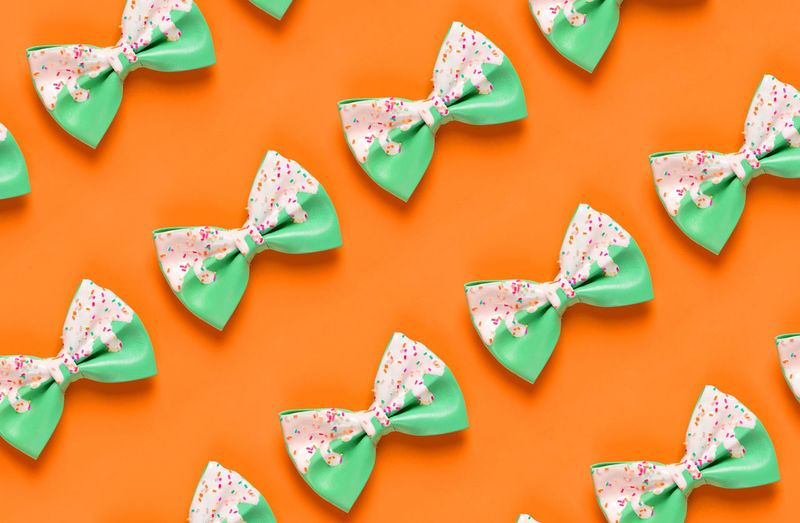 Bow ties over orange background