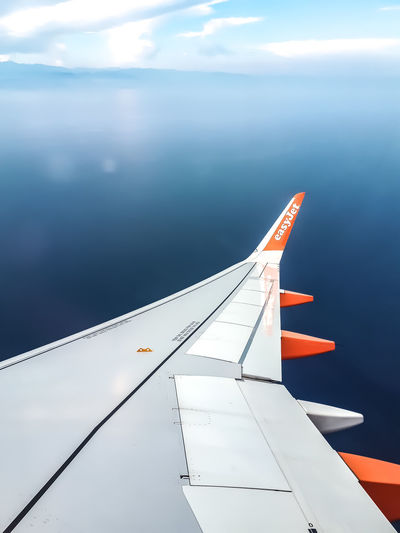 EasyJet Airplane Flying Air Vehicle Aircraft Wing Aerial View Space Journey Sky Cloud - Sky Travel Aeroplane Airplane Wing Fighter Plane Commercial Airplane Military Airplane Jet Engine Cloudscape Calm Sky Only Shore Private Airplane Airport Runway Aerospace Industry Airplane Mechanic Meteorology Formation Flying Corporate Jet Airshow Runway