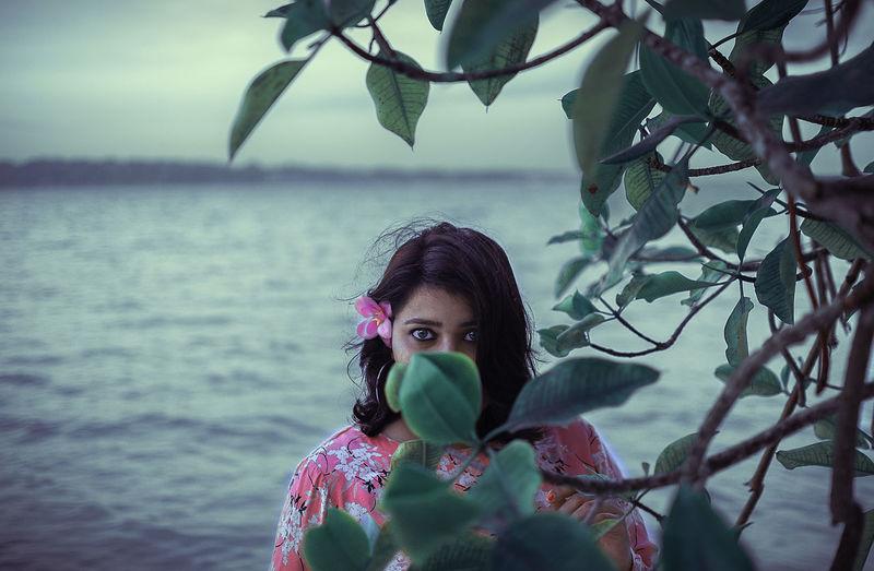Portrait of woman against plants