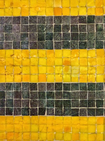 Exploring Style Yellow Full Frame Textured  Outdoors No People Backgrounds Black Mosaic Streetart Architecture Close-up Bright Colors Lines Brick Wall Abstract