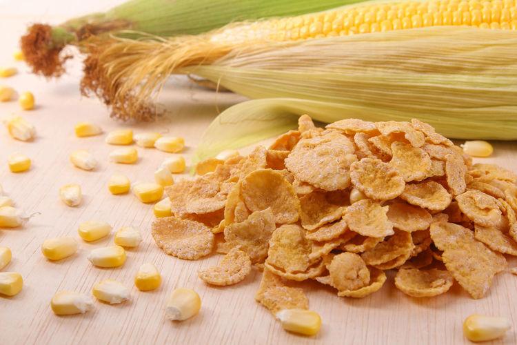 High angle view of corns and food on table