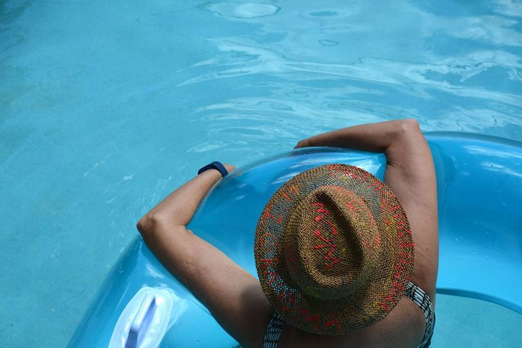 afloat EyeEm Selects High Angle View Leisure Activity Water Floating On Water Floating Floating In Water Woman Summer Vibes Summertime Vacation Swimming Pool Inflatable Ring Sunhat Hat Straw Hat Sun Hat Inflatable  Float