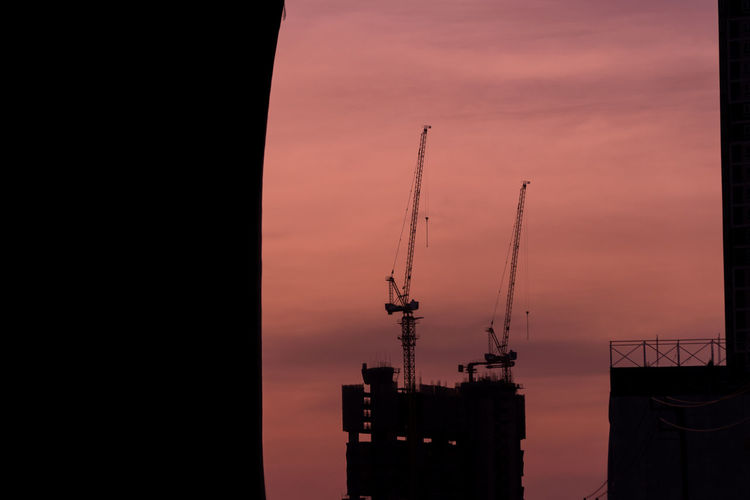 Architecture Building Exterior Built Structure City Construction Site Crane Crane - Construction Machinery Day Development Industry Nature No People Outdoors Shipyard Silhouette Sky Sunset