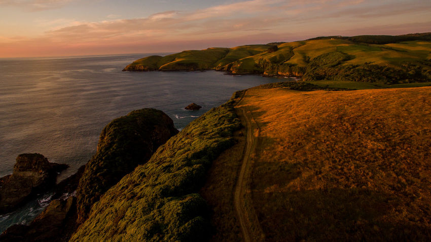 aerial drone shot over new zealand with water and farm fields Aboutpassion Aerial Landscape Beach Beauty In Nature Cliff Cloud - Sky Coastline Horizon Over Water Land Nature No People Outdoors Rock Rock - Object Scenics - Nature Sea Sky Solid Sunset Tranquil Scene Tranquility Vanlife Water