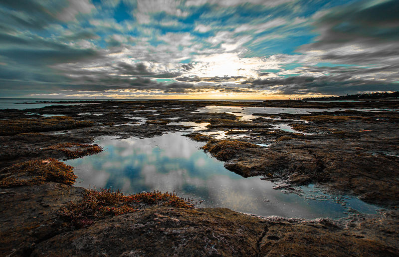 tidal pool Water Sky Cloud - Sky Beauty In Nature Scenics - Nature Tranquility Nature Tranquil Scene Reflection No People Sea Land Beach Sunset Day Non-urban Scene Motion Outdoors Long Exposure Jason Gines
