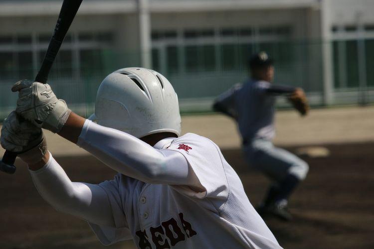 Rear view of a baseball hitter