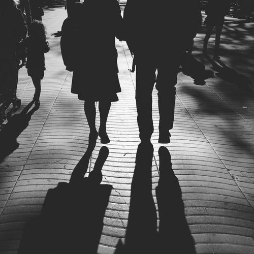 Silhouette Couple Walking On Street
