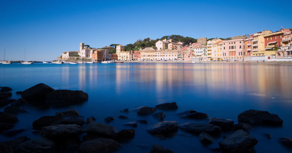 Silence bay - Sestri Levante (Baia del Silenzio) Architecture Bay Beach Blue Building Exterior Built Structure City Clear Sky House Italy Liguria Long Exposure Nature Nd1000 No People Outdoors Reflection Residential Building Rock Sea Sestri Sestri Levante Silence Water Waterfront