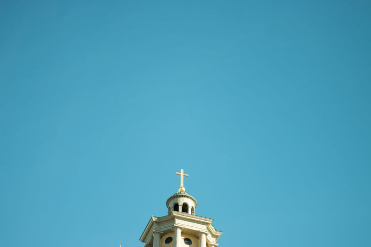 Low Angle View Of Church Against Clear Blue Sky