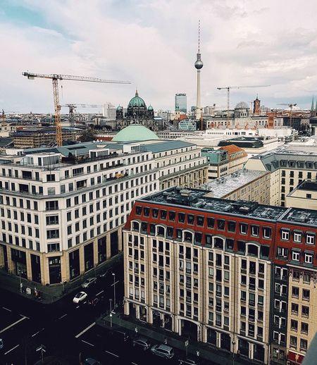 Fernsehturm Amidst Cityscape Against Sky