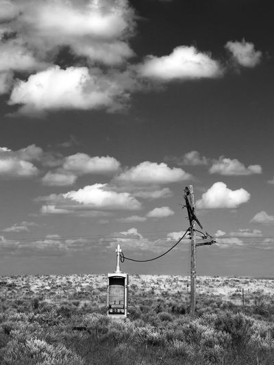 Tethered Black And White Cloud Cloud - Sky Cloudy Desert Scrub High Plains Monochrome No People Outdoors Prairie Railroad Railroad Telegraph Railroad Track Remote Sky
