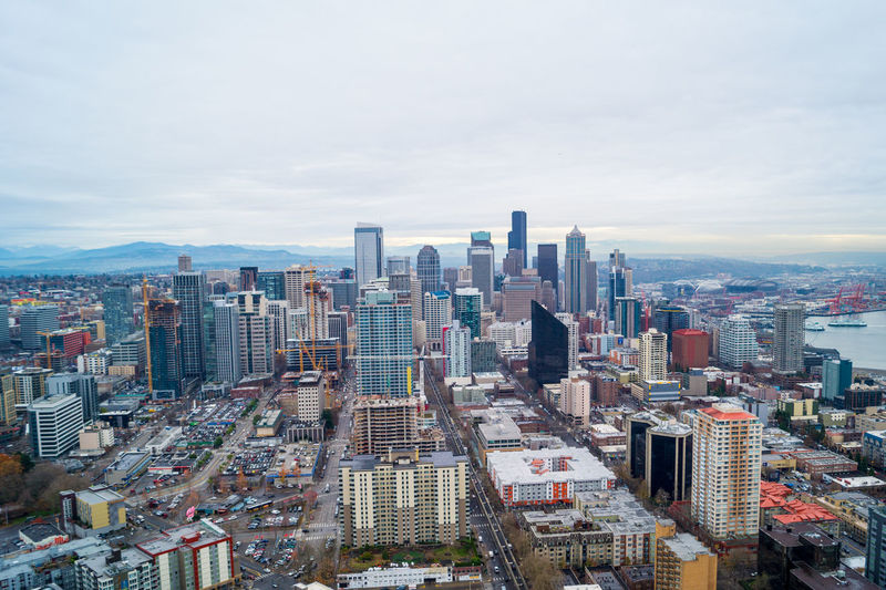 Seattle cityscape, view from the Space Needle Aerial View Architecture Building Exterior Built Structure Capital Cities  City City Life Cityscape Cloud Cloud - Sky Day Financial District  Modern No People Office Building Outdoors Residential District Sky Skyline Skyscraper Tall Tall - High Tower Travel Destinations Urban Skyline